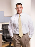 Businessman with hands in pockets Stock Photo