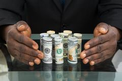 Businessman Hands Protecting Banknotes Stock Photos