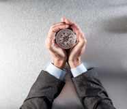 Businessman hands protecting a compass, leading the company perspective Royalty Free Stock Photography