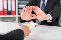 Businessman hands rejecting an offer of money Royalty Free Stock Image
