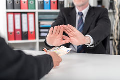 Businessman hands rejecting an offer of money Stock Photo