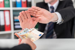 Businessman hands rejecting an offer of money Royalty Free Stock Photography