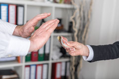 Businessman hands rejecting an offer of money Royalty Free Stock Photo