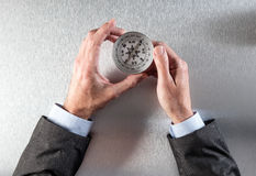 Businessman hands searching his corporate way forward with a compass Stock Photography