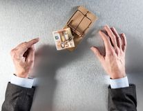 Businessman hands showing hesitation facing euro money in mouse trap Stock Photos