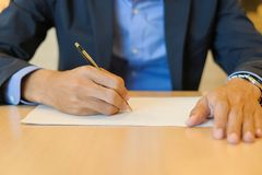 Businessman hands signing on document royalty free stock photo