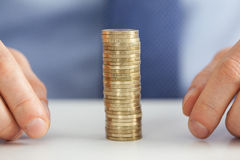 Businessman hands and stack of coins Stock Photo
