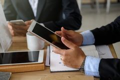 Businessman hands with tablet and smartphone Royalty Free Stock Image