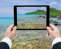 Businessman hands tablet taking pictures beach and sea Royalty Free Stock Images
