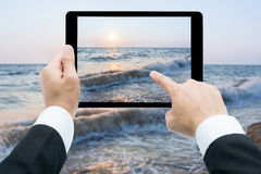 Businessman hands tablet taking pictures beach and sea Stock Photography
