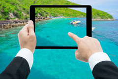 Businessman hands tablet taking pictures beach and sea Royalty Free Stock Photos