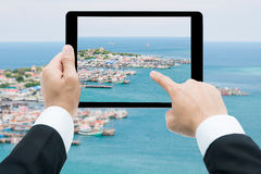 Businessman hands tablet taking pictures beach and sea Stock Photos