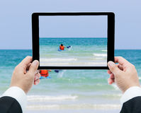 Businessman hands tablet taking pictures canoe Royalty Free Stock Image