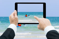 Businessman hands tablet taking pictures canoe Royalty Free Stock Images