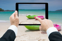 Businessman hands tablet taking pictures canoe Stock Images