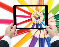 Businessman hands tablet taking pictures close up color pencils Stock Photo
