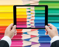 Businessman hands tablet taking pictures close up color pencils Stock Photos