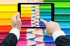 Businessman hands tablet taking pictures close up color pencils Stock Image