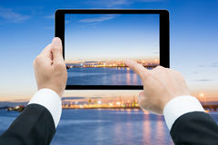 Businessman hands tablet taking pictures Commercial docks at sun Royalty Free Stock Image