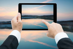 Businessman hands tablet taking pictures Sam Phan Bok rock canyo Royalty Free Stock Images