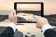 Businessman hands tablet taking pictures Sam Phan Bok rock canyo Royalty Free Stock Image