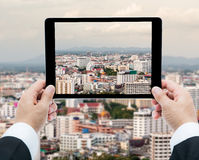 Businessman hands tablet taking pictures view edifice of city Royalty Free Stock Images