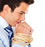 Businessman with hands tied Stock Images