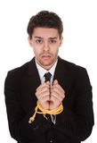 Businessman with hands tied in network cable Stock Photography