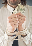 Businessman with hands tied in ropes Stock Photography
