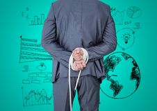 Businessman hands tied up with rope against graphic business concept Stock Photos