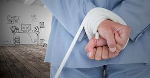 Businessman hands tied up with rope against graphic concept Royalty Free Stock Photos