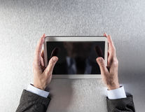 Businessman hands touching a media screen on his office desk Stock Photography