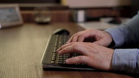 Businessman hands typing on the keyboard. Blue shirt. Wooden table. Motorized slider footage video. Businessman hands typing on the keyboard. Blue shirt. Wooden stock video