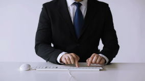 Businessman hands typing on keyboard Stock Images