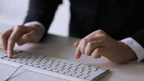 Businessman hands typing on keyboard stock video