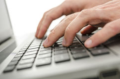 Businessman hands typing on laptop keyboard Royalty Free Stock Photography
