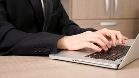 Businessman hands typing on laptop keyboard. Dolly footage. Close up stock footage