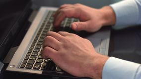 Businessman hands typing on laptop, pressing buttons on keyboard. Stock footage stock video