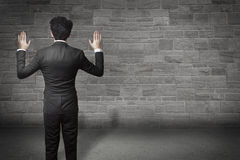 Businessman hands up wall Stock Photography