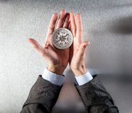 Businessman hands using a compass, searching for the company direction Royalty Free Stock Images