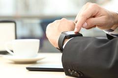Businessman hands using a smart watch Stock Photography
