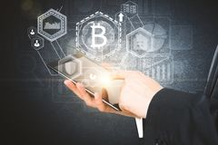 E-commerce concept. Businessman hands using tablet with abstract glowing bitcoin projection. E-commerce concept. 3D Rendering Royalty Free Stock Photo