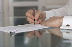 Businessman hands working on paper document Royalty Free Stock Photography