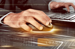 Businessman hands working with wireless mouse and laptop Stock Photo