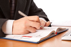 Businessman hands writing in organizer Stock Photo