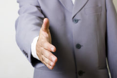 Businessman handshake. Businessman asking to handshake (silver suit Stock Photos