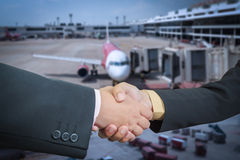 Businessman handshake with air plane transportation Royalty Free Stock Images
