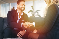 Businessman handshake with businesswoman in office Royalty Free Stock Image