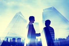 Businessman Handshake and Cityscape Background stock photo