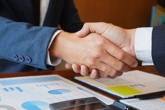 Businessman handshake consulting businessman meeting brainstorming report project analyze stock images